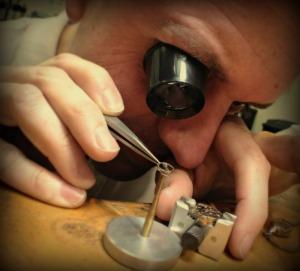 alan fixing watch