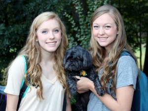 From left, Hannah and Haley on their first day of college in August 2014, pictured with their homeschool mascot, Annabell the Shih Tzu. Photo by Lisa Speights