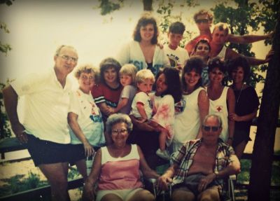 The Neel Family, circa 1989.  Nanny and Pawpaw sit in front, just happy as pie.  Heather is in the front middle, holding her cousin. Behind her are her sister and mom, along with the rest of the Neel cousins, aunts, and uncle. Photo courtesy Heather Harrison.