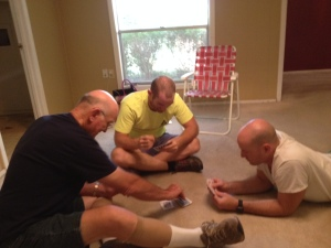 Don, Coop, and Ben Powers play cards in the empty old house. Photo by Shelley Powers